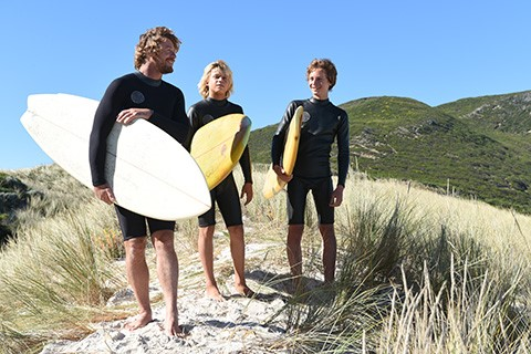 Three males with surfboards